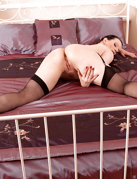 Attractive brunette honey wearing sexy lingerie and stockings taking dildo up twat