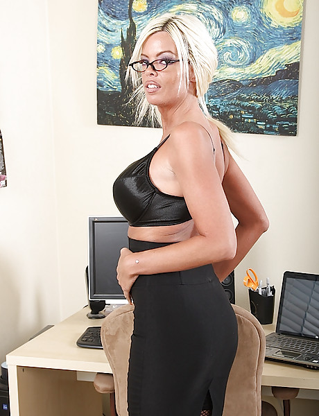 Naughty blonde secretary with huge bazookas sticking dildo up her pierced cunny