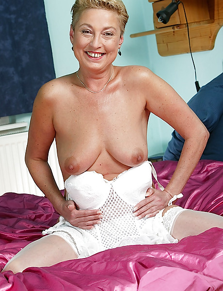 Tanned blonde momma with big breast wearing sexy white underwear playing with dildo