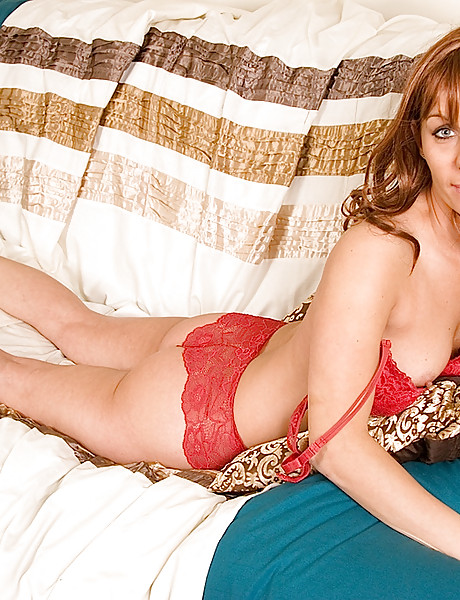 Bootylicious tanned brunette wearing sexy red lace lingerie revealing shaved vagina