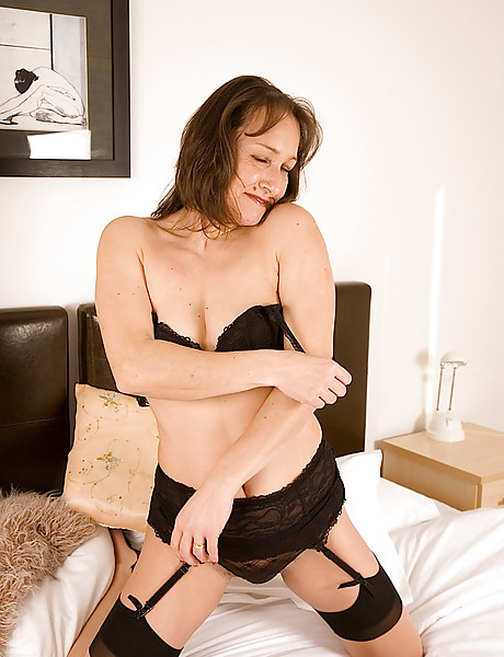 Randy brunette milf with small tits wearing sexy black underwear playing with sex toy