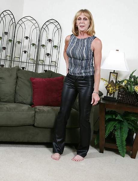 horny black leather - Horny granny in tight leather black pants stripping and teasing with her  saggy boobs