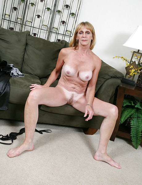 Horny granny in tight leather black pants stripping and teasing with her saggy boobs