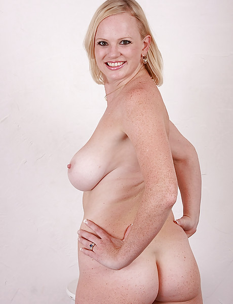 Sexy blonde with huge hanging boobs stripping and showing her tasty shaved pussy
