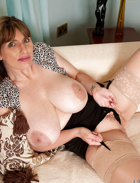 Sexy milf with big massive hanging boobs sripping and teasing with her pussy