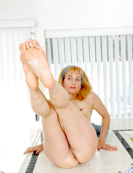 Horny blonde stripping and teasing with her sexy feet and fingering her shaved pussy