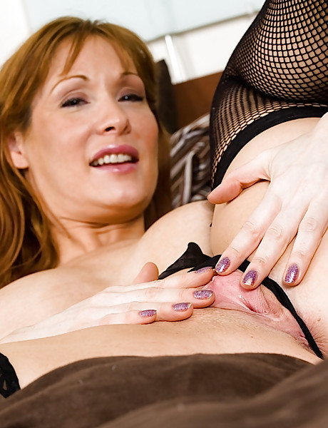 Sexy milf with a big meaty round ass and a soft shaved pussy stripping and teasing