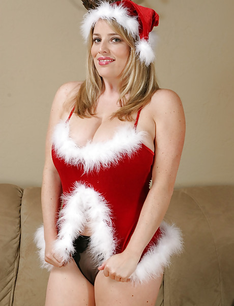 Sexy blonde dressed up as Santa's helper licking her boobs and fingering her pussy