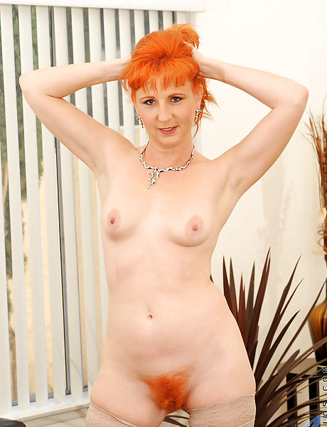 Hot ginger with small perky boobs and a big ginger bush masturbating with a dildo