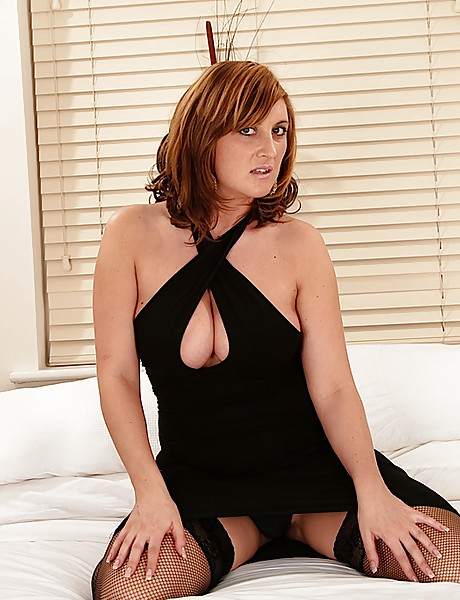 Hot curvy milf in hot black stockings and a sexy black dress stripping and posing