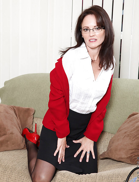 Hot brunette secretary in sexy black lingerie and hot black stockings stripping