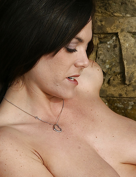 Hot brunette busty milf loves getting naked and masturbating in the outside