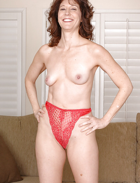 Sexy milf in a hot red dress stripping and teasing stretching her wet hairy pussy
