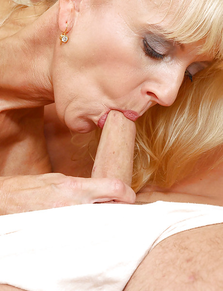 Horny blonde mature slut can't get enough of fucking and licking a young hard cock