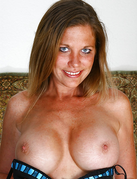 Sexy mature mama with a hot body and huge round tits playing with her g-strings
