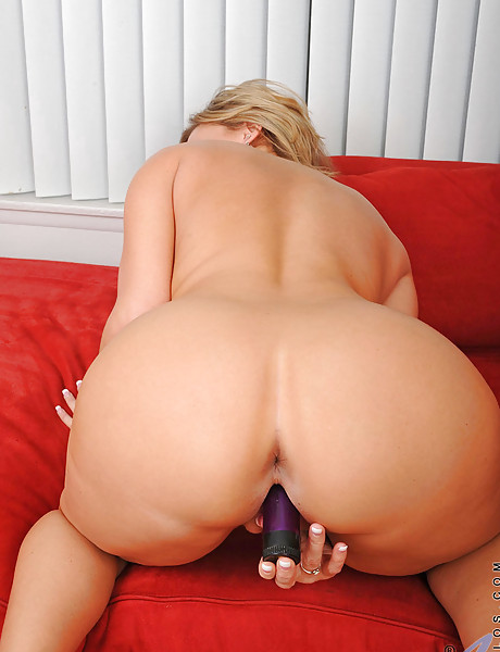 Hot blonde milf with natural hanging boobs masturbating with a big purple dildo