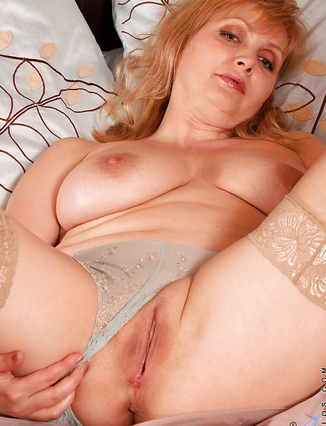 Sexy curvy mama with massive hanging boobs masturbating with a purple dildo