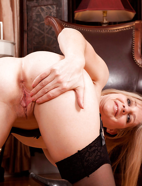 Hot mature blonde in sexy black lingerie and hot black stockings showing her pussy