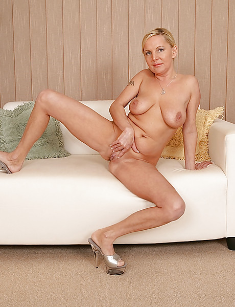 Hot blond mature babe in sexy black lace stripping slowly and showing her sexy body