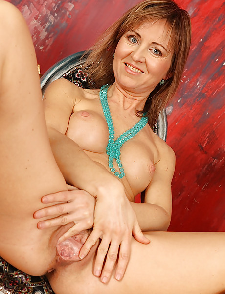 Sexy mature classy milf with hot boobs gets naked and horny and fingers her pussy