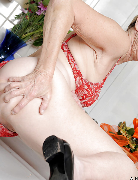 Slutty granny in a hot red vintage bikini gets naked and all wet in the bathroom