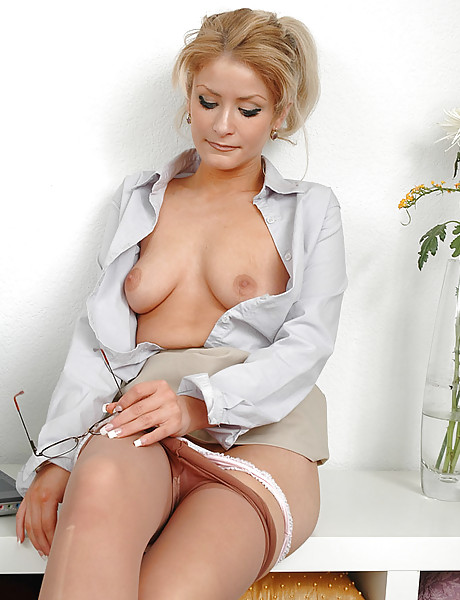 Sexy mature blonde taking her clothes off slowly and showing her meaty pussy