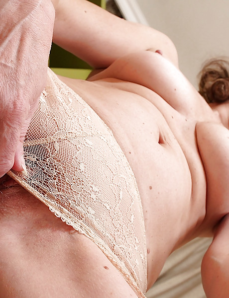 Hot granny with a big meaty hairy pussy with huge clit opening it wide and fingering
