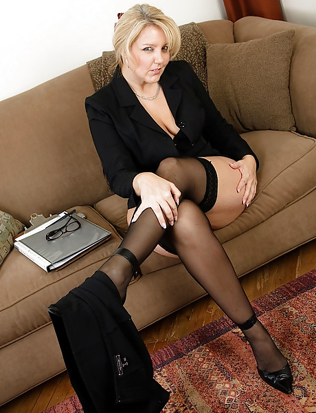 Hot curvy busty blond secretary masturbates on a couch while having hot phone sex