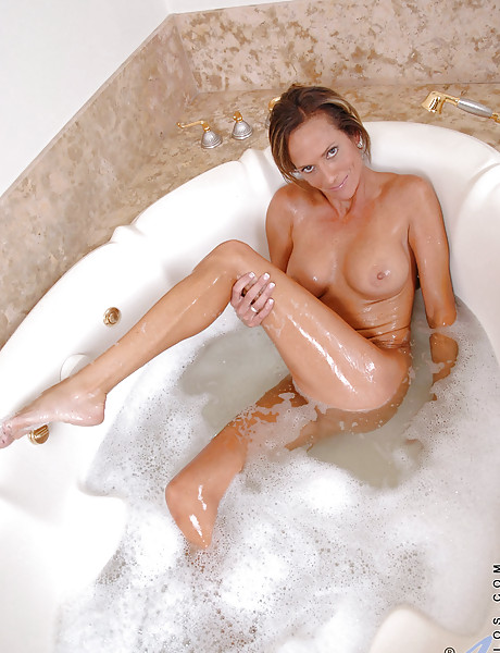 Beautiful and cute MILF babe taking a bath and masturbating in the bath tube