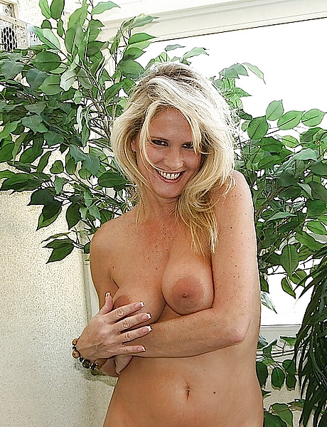 Horny and cute blond babe gets rid of her cute dress and shows her sexy naked body