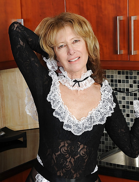 Sexy blond babe gets off her maid outfit and shows her tight pussy and big tits