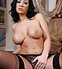 Busty brunette classy MILF strips her lingerie and gets screwed in black stockings