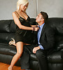 Classy blonde MILF takes her black dress off and takes a wild ride on big cock.