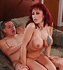 Busty redhead MILF bitch removes her black lingerie and gets fucked hard and fast.