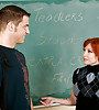 Classy redhead MILF teacher seduces her student in detention and sucks his cock.
