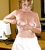 Horny brunette secretary with glasses wearing white hot underwear playing with dildo
