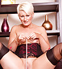 Sexy blonde with nce boobs wearing hot black corsette and stockings playing with cunt