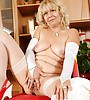 Horny granny in sexy white stockings and a sexy white hat fingering her pussy