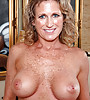 Horny milf with gorgeous big boobs and sexy freckles all over them stripping