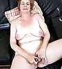 Horny granny with a soft mature curvy body and saggy boobs masturbating with a dildo
