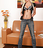 Sexy blonde in tight blue jeans strips everything off and masturbates on leather sofa
