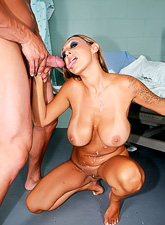 Foxy huge breasted MILF babe takes her clothes off and rides a big stiff dong