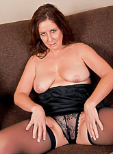 Busty and classy brunette vixen takes her lingerie off and fingers her vagina