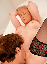 Horny blonde mature lady wears black stockings as she gets her vagina eaten out