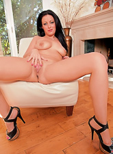 Busty brunette angel takes her black panties off and fingers her wet hungry muff