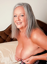 Big breasted classy granny strips her lingerie on the bed and fingers her old muff