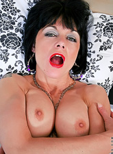Big breasted classy mature vixen spreads her legs and toys her wet hungry muff