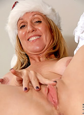 Horny blonde mature mom takes her lingerie off and fingers her hungry vagina