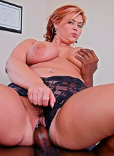 Slutty redhead MILF doctor takes her uniform off and fucks with hung horny patient