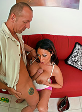 Big breasted brunette hoe kneels before her well hung lover and sucks big hard cock